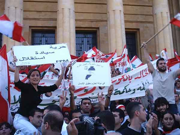 """Liberty - Sovereignty - Independence "" is the popular slogan shouted by Lebanese protesters denouncing Syrian occupation"